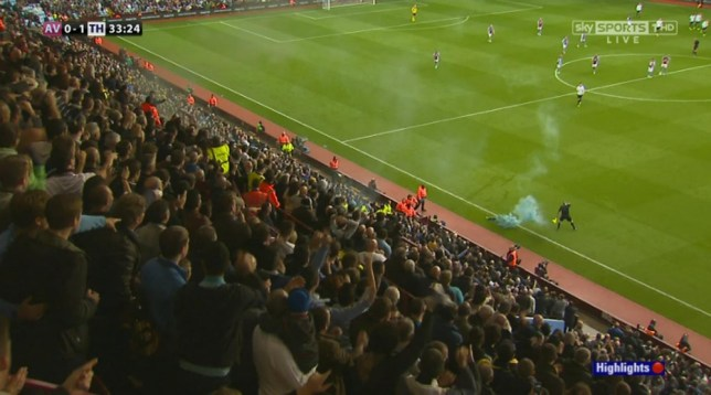 ****Ruckas Videograbs****  (01322) 861777 *IMPORTANT* Please credit SKY for this picture. Flare thrown onto picth and hits the linesman. 20/10/13  Aston Villa V Tottenham Office  (UK)  : 01322 861777 Mobile (UK)  : 07742 164 106 **IMPORTANT - PLEASE READ** The video grabs supplied by Ruckas Pictures always remain the copyright of the programme makers, we provide a service to purely capture and supply the images to the client, securing the copyright of the images will always remain the responsibility of the publisher at all times. Standard terms, conditions & minimum fees apply to our videograbs unless varied by agreement prior to publication.