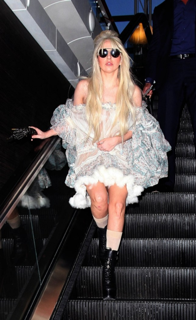 22.OCTOBER.2013 - LOS ANGELES - USA LADY GAGA ROCKS A BIZARRE TRANSLUCENT OUTFIT WHILE LEAVING LOS ANGELES INTERNATIONAL AIRPORT ON HER WAY TO LONDON. BYLINE MUST READ : XPOSUREPHOTOS.COM *AVAILABLE FOR UK SALE ONLY* ***UK CLIENTS - PICTURES CONTAINING CHILDREN PLEASE PIXELATE FACE PRIOR TO PUBLICATION *** *UK CLIENTS MUST CALL PRIOR TO TV OR ONLINE USAGE PLEASE TELEPHONE 020 8370 0291 & +1 310 562 7073*
