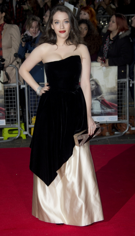 Kat Dennings lights up Thor: The Dark World red carpet by showing off her famous chest