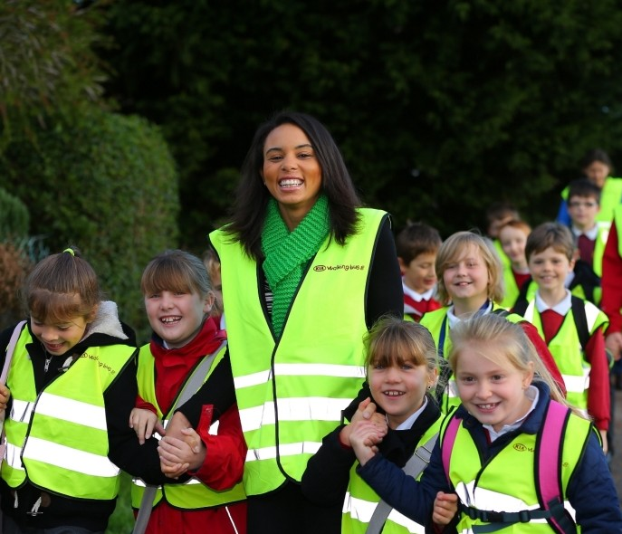 Olympian Louise Hazel with children from Lytchett Matravers Primary School