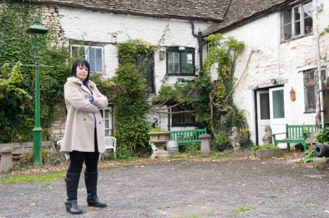 PIC BY DAN ROWLANDS / CATERS NEWS - (PICTURED: Caroline Humphries outside the Ancient Ram) - This is Britains most haunted B&B - where terrified guests have been left so scared they have even jumped out of the WINDOWS. The Ancient Ram Inn, in Gloucester, is believed to be riddled with up to TWENTY spooky spectres who torment the paying punters of the 12th century home. Built on an ancient pagan burial ground, believed to be the scene of child sacrifices, the Cotswolds cottage is haunted by the likes of a murdered young girl called Rosie, a high priestess - and even a SEX DEMON. Even our own investigators witnessed strange goings on, including a blood-curdling childs scream, electrified wooden beams, and even the touch of an invisible force. SEE CATERS COPY.