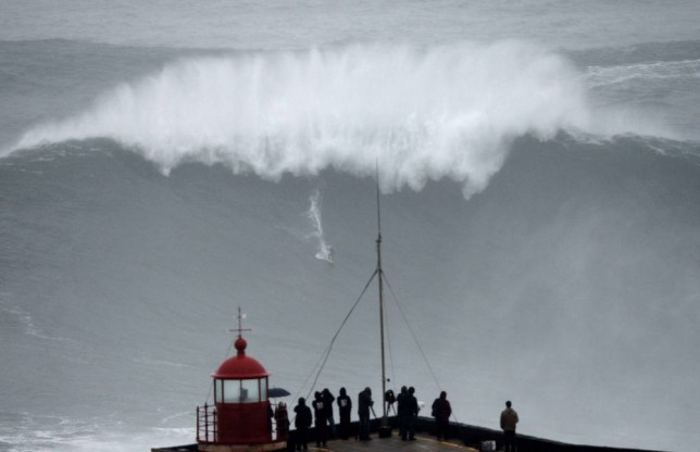 Brazilian big wave surfer Carlos Burle rides a wave in Nazare, central Portugal, on October 28, 2013.  AFP PHOTO/ FRANCISCO LEONGFRANCISCO LEONG/AFP/Getty Images