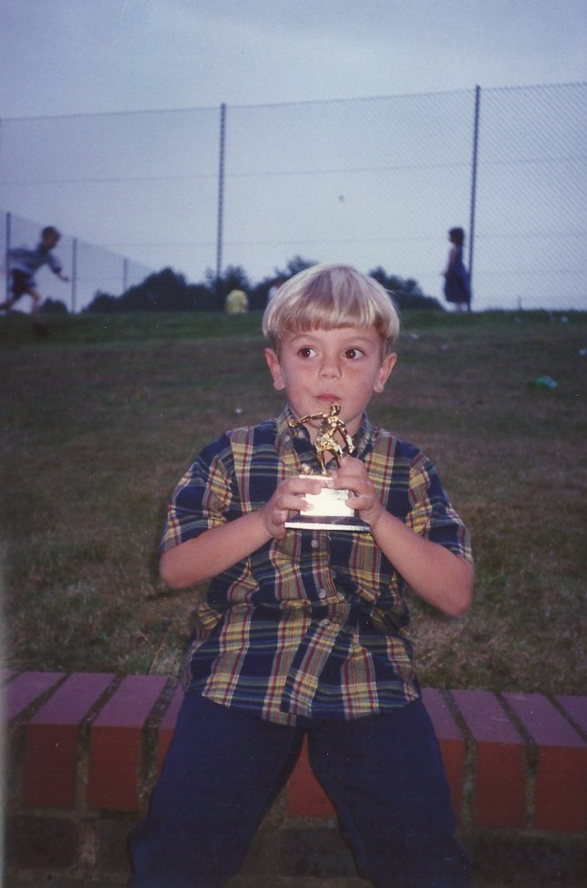 Which current Arsenal player is pictured receiving his first ever trophy?