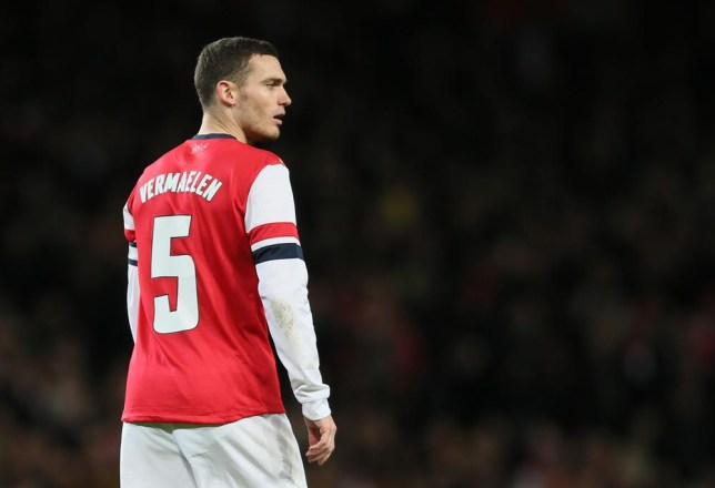 Arsenal's Thomas Vermaelen looks to his right as he watches his teammates during their English League Cup soccer match between Arsenal and Chelsea at the Emirates stadium in London Tuesday, Oct. 29, 2013. AP