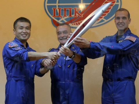 VIDEO: Olympic torch reaches International Space Station on troubled journey to Winter Games