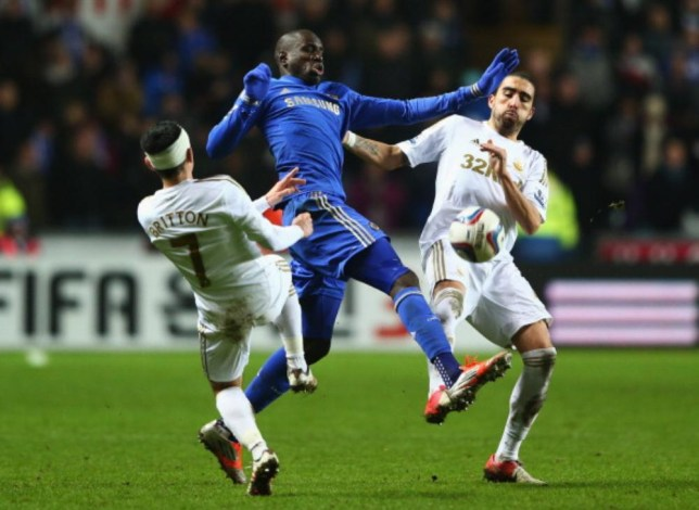 SWANSEA, WALES - JANUARY 23: Demba Ba of Chelsea takes on Leon Britton Michael Steele/Getty Images
