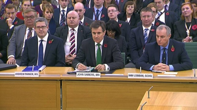 Andrew Parker the head of M15,  John Sawers the head of M16 and Iain Lobban GCHQ director (L-R) are seen attending an Intelligence and Security Committee hearing at Parliament, in this still image taken from video in London November 7, 2013. Britain's intelligence chiefs gave their first ever public testimony on Thursday when they were cross-examined together in parliament about the case of former U.S. spy agency contractor Edward Snowden. REUTERS/UK Parliament via REUTERS TV  (BRITAIN - Tags: CRIME LAW POLITICS SOCIETY) FOR EDITORIAL USE ONLY. NOT FOR SALE FOR MARKETING OR ADVERTISING CAMPAIGNS