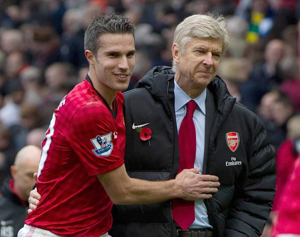 Man Utd's Robin Van Persie and Arsenal manager Arsene Wenger at Old Trafford. MANCHESTER UNITED V ARSENAL AT OLD TRAFFORD -  PIcture by Ian Hodgson/Daily Mail