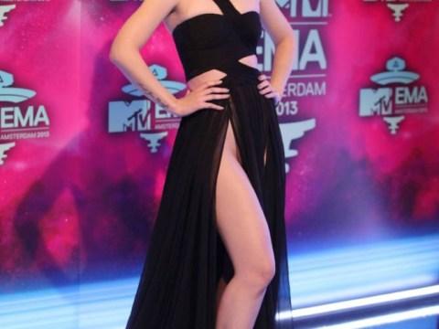 Iggy Azalea denies baring all in daring dress at MTV EMAs – but admits flashing her bum