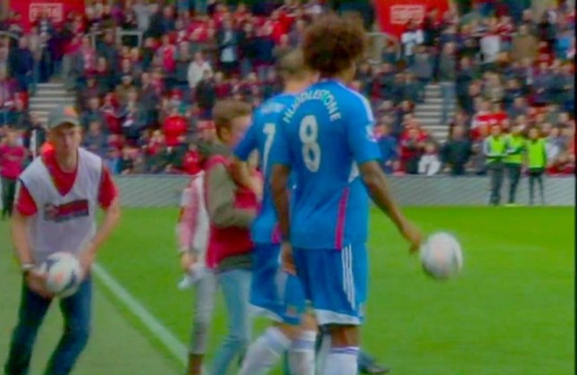 David Meyler, partially hidden by Tom Huddlestone, tackles the young Saints fan (Picture: YouTube)