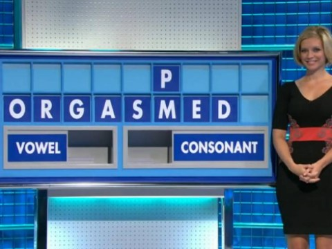 Attractive woman stands next to naughty word on TV