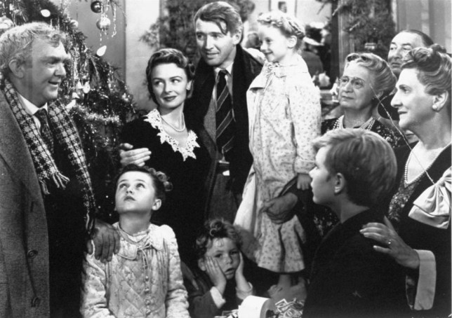 "**FILE** James Stewart, center, is reunited with his wife, Donna Reed, left, and children during the last scene of Frank Capra's 1946 classic, ""It's A Wonderful Life."" For its ninth annual celebration of cinema, the American Film Institute aims to uncover the ""most inspirational films of the century."" A list of 300 films deemed inspirational by AFI historians will be considered. Ballots went out this week to more than 1,500 actors, producers, writers and others in the industry. Among the suggestions are ""The Passion of the Christ,"" ""The Sound of Music,"" ""It's a Wonderful Life"" and ""8 Mile."" (AP Photo)"
