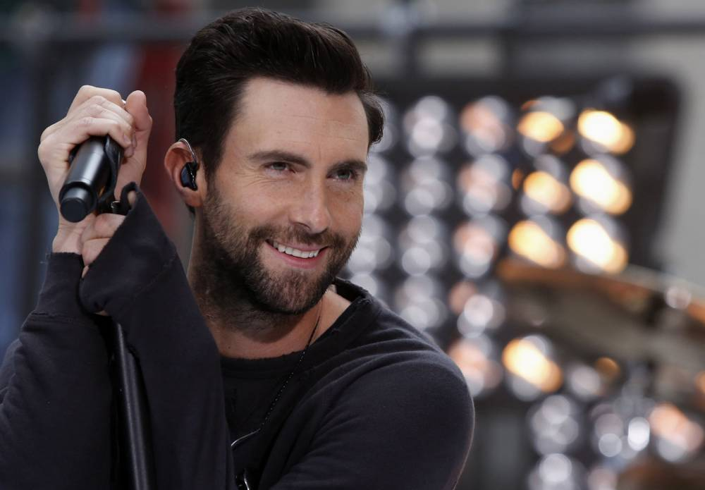 """Singer Adam Levine performs with his band Maroon 5 on NBC's 'Today' show in New York in this June 14, 2013 file photo. Levine, the frontman of the Grammy Award-winning rock group Maroon 5 and a judge on the hit NBC singing show """"The Voice,"""" was named People magazine's sexiest man alive, the magazine announced on November 19, 2013. REUTERS/Brendan McDermid/Files (UNITED STATES - Tags: ENTERTAINMENT PROFILE HEADSHOT)"""