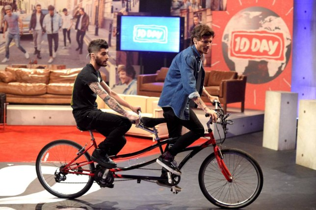 PLAYA VISTA, CA - NOVEMBER 23:  Zayn Malik (L) and Louis Tomlinson on set during One Direction celebrates 1D Day at YouTube Space LA, a 7-hour livestream event broadcast exclusively on YouTube and Google+. Featuring behind the scenes footage, Guinness world record attempts, and amazing special guests, the global event also marked the premiere of tracks from their new album 'Midnight Memories', set for release November 25th, in Playa Vista, California on November 23, 2013  (Photo by Jeff Kravitz/FilmMagic)