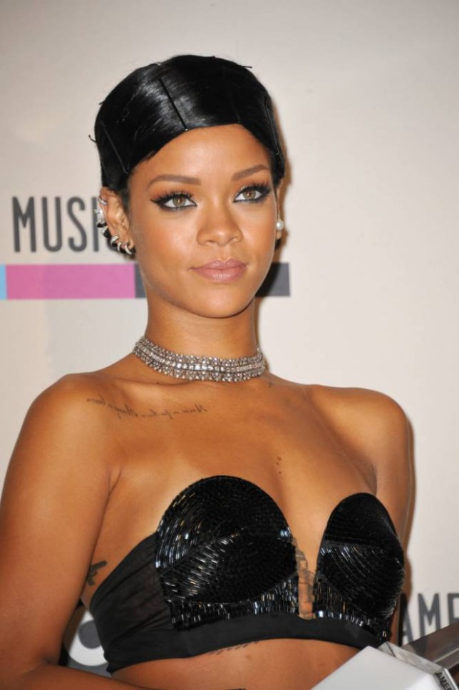 Rihanna poses backstage with the Icon award at the American Music Awards at the Nokia Theatre L.A. Live on Sunday, Nov. 24, 2013, in Los Angeles. (Photo by Jordan Strauss/Invision/AP)
