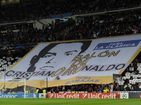 Face masks, placards and banners support Cristiano Ronaldo's Ballon d'Or bid during Real Madrid v Galatasaray game