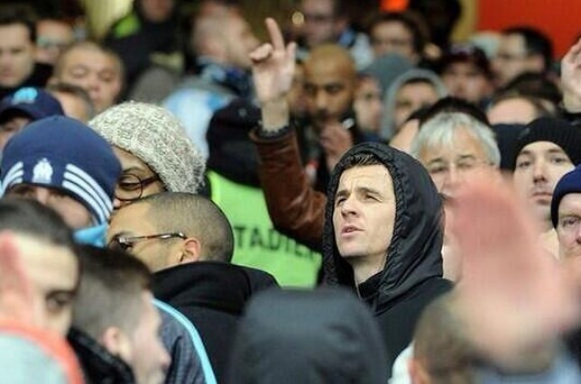 Barton stands with Marseille supporters at the Emirates