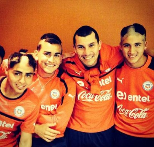 Chile's new recruits show off their hairdos (Picture: @MedelPitbull)