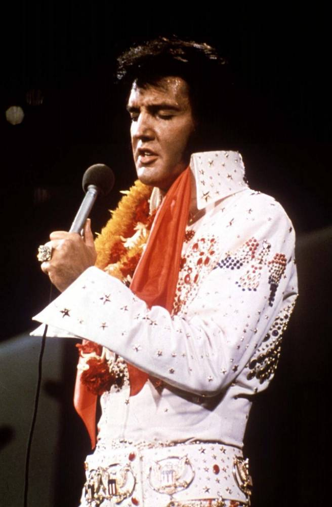"""Elvis Presley performs in concert during his   """"Aloha From Hawaii"""" 1972 television special. As millions of fans prepare to mark the 20th anniversary of  Presley's death August 16, the spirit of the man who changed the sound of music lives on.  NO SALES NO ONLINES  cm/CREDIT -CORBIS /BETTMANN-UPI  FOR ONE TIME EDITORIAL USE WITHIN 90 DAYS OF TRANSMISSION      REUTERS...I...ENT PRO BC ELVIS FEATURE 1972 FILE PHOTO ELVIS PRESLEY...WAS99:FEATURE:LOS ANGELES,11AUG97 -FOR RELEASE WITH STORY BC-USA-ELVIS - 1972 FILE PHOTO -"""