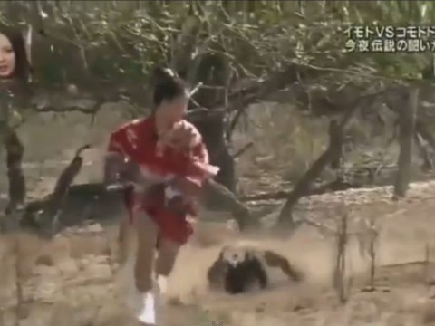 Oh look, it's a woman tied to meat running from a Komodo dragon