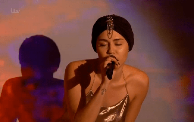 Miley managed to cover up for the performance (Picture: ITV)