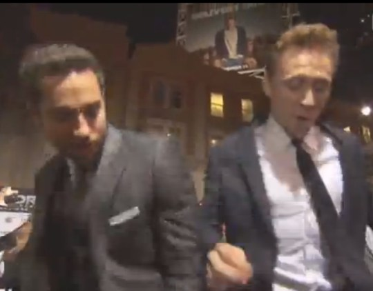 Tom Hiddleston shows off his best moves with Zachary Levi (Picture: Extra/YouTube)
