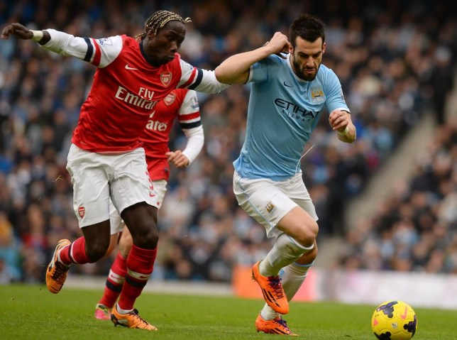 Arsenal's French defender Bacary Sagna (L) vies with Manchester City's Spanish forward Alvaro Negredo (R) during the English Premier League football match between Manchester City and Arsenal at the Etihad Stadium in Manchester, northwest England, on December 14, 2013. AFP PHOTO / ANDREW YATES RESTRICTED TO EDITORIAL USE. No use with unauthorized audio, video, data, fixture lists, club/league logos or live services. Online in-match use limited to 45 images, no video emulation. No use in betting, games or single club/league/player publications. ANDREW YATES/AFP/Getty Images