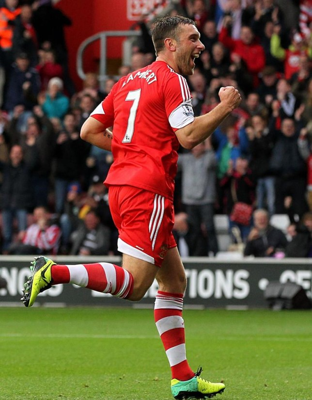 Southampton's Rickie Lambert celebrates scoring his side's second goal of the game from the penalty spot against Hull City during the English Premier League match at St Mary's, Southampton, England, Saturday, Nov. 9, 2013. (AP Photo/PA, Sean Dempsey) UNITED KINGDOM OUT
