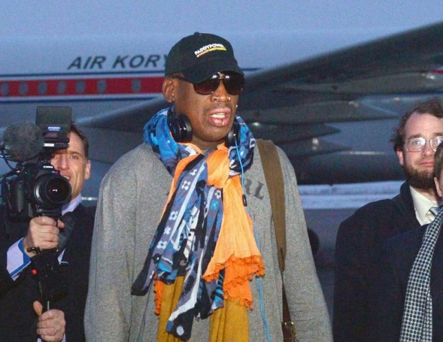 Dennis Rodman arrives at Pyongyang airport this morning (Picture: Reuters)