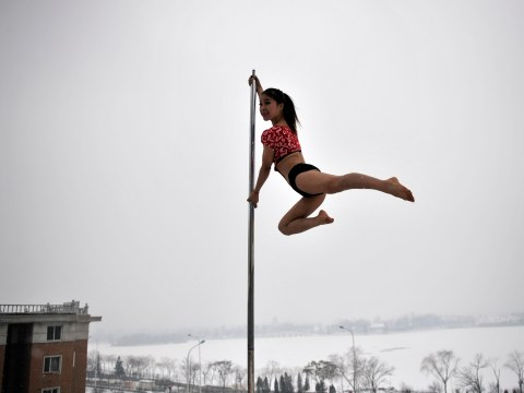 Gallery: China's national pole dancing team practice in the snow
