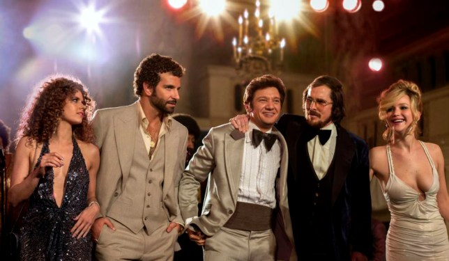 "This film image released by Sony Pictures shows, from left,  Amy Adams, Bradley Cooper, Jeremy Renner, Christian Bale and Jennifer Lawrence in a scene from ""American Hustle."" While shooting in Boston, David O. Russellís upcoming fictionalization of the Abscam investigation, ìAmerican Hustle,î found itself caught up in the Boston Marathon bombing. When the city was essentially shut down for the manhunt, the production had to be stopped for a day. The experience, Russell says, was felt closely by the production. (AP Photo/Sony - Columbia Pictures, Francois Duhamel)"
