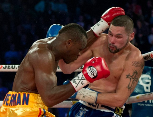 Adonis Stevenson, left, of Canada, trades blows with Tony Bellew, of England, in their WBC light heavyweight title fight in Quebec City early Sunday, Dec. 1, 2013. (AP Photo/The Canadian Press, Jacques Boissinot)