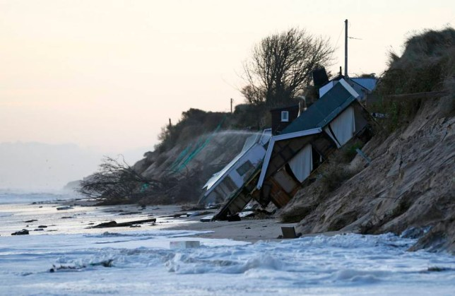 UK weather: Cliff homes swept into sea after worst storm in 60 years