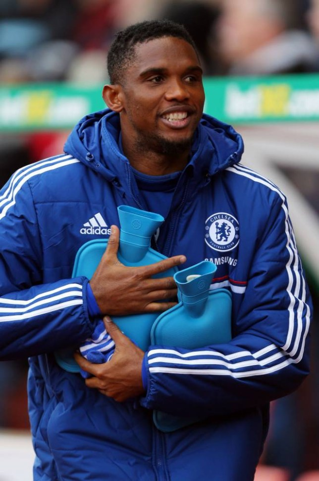 Chelsea's Samuel Eto'o clutches two hot water bottles before the Barclays Premier League match at the Britannia Stadium, Stoke. PRESS ASSOCIATION Photo. Picture date: Saturday December 7, 2013. See PA story SOCCER Stoke. Photo credit should read: Dave Thompson/PA Wire. RESTRICTIONS: Editorial use only. Maximum 45 images during a match. No video emulation or promotion as 'live'. No use in games, competitions, merchandise, betting or single club/player services. No use with unofficial audio, video, data, fixtures or club/league logos.