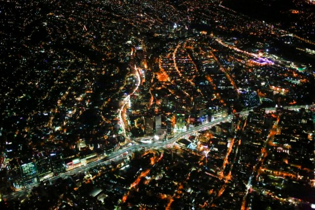 An aerial view of Mexico city at night from an airplane, December 16, 2013. REUTERS/Jorge Silva (MEXICO - Tags: CITYSCAPE SOCIETY)