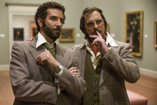Richie Dimaso (Bradley Cooper, left) and Irving Rosenfeld (Christian Bale) talk in a gallery at the Frick Museum in American Hustle (Picture: Columbia Pictures)