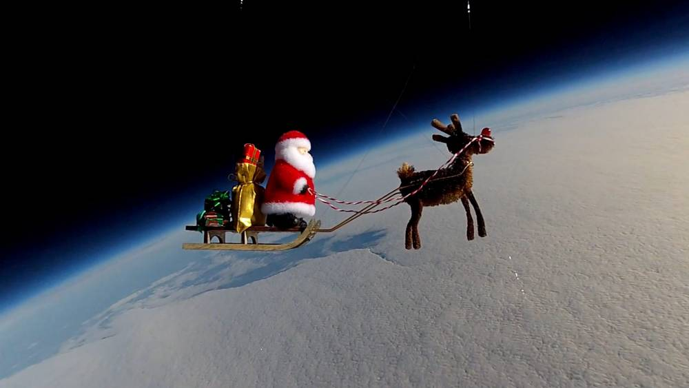 """A pair of science fans have used Christmas to show off their skills by sending Father Christmas into orbit. Mark Ireland and Cassie Phelps attached a high altitude weather balloon and camera to a makeshift Santa and Rudolph. See swns story SWSLEIGH. They then launched the balloon and watched it disappear into the sky. Within two hours, Santa and Rudolph were 100,000ft above the earthís surface with the camera capturing incredible views of the earthís curvature. Eventually, the helium filled balloon - which cost around £50 - popped and the payload started to fall to the ground. At this point a parachute opened and it slowed down before landing 70 miles away from its launch position in the Forest of Dean. Cassie, 27, said: """"It is a personal project which we have been working on. We watched a Lego man go into space on YouTube and thought ëletís have a goí. """"We started sending normal cameras into space and, with Christmas coming up, decided to send Santa into sky. """"We got clearance from the Civil Aviation Authority and launched on December 1. It set off from the Forest of Dean and about two-and-a-half hours later it landed in Yeovil in Somerset."""