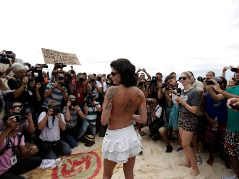 Topless protest unsurprisingly attracts hundreds of men but less than a dozen women