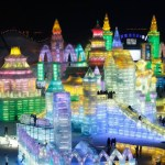 epa04003841 People tour between the large-scale ice sculptures at the 15th Harbin Ice and Snow World in Harbin, Heilongjiang province, China, 30 December 2013. Some 180,000 cubic meters of ice and 150,000 cubic meters of snow were used to build the 600,000-square-meter ice wonderland.  EPA/Hao Bin CHINA OUT