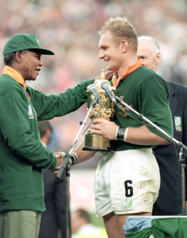 South African rugby captain Francois Pienaar receives the William Webb Wellis Trophy from President Nelson Mandela after they defeated New Zealand to win the Rugby World Cup Final at Ellis Park, Johannesburg, South Africa.    24 Jun 1995:    Mandatory Credit: Dave Rogers /Allsport