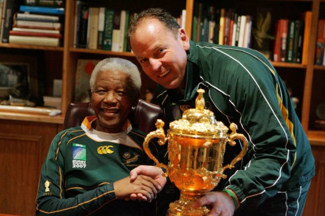 JOHANNESBURG, SOUTH AFRICA - 27: Former South Africa President Nelson Mandela poses with South Africa Rugby Union coach Jake White and the Webb-Ellis cup during the Springboks visit to Nelson Mandela at his residence on October 27, 2007 in Houghton, Johannesburg, South Africa. South Africa became the current holders of the cup after defeating Former champions England 15-6 in the 2007 Rugby World Cup Final. (Photo by Lefty Shivambu/Gallo Images/Getty Images)