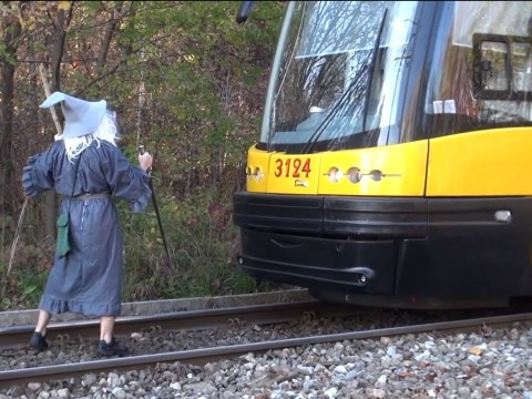 Man dresses up as Gandalf to recreate Lord of the Rings scene with a tram
