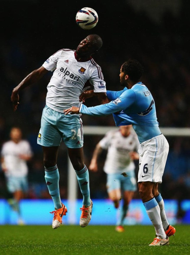 MANCHESTER, ENGLAND - JANUARY 08: Carlton Cole (L) of West Ham United rises above Joleon Lescott of Manchester City during the Capital One Cup Semi-Final first leg match between Manchester City and West Ham United at at Etihad Stadium on January 8, 2014 in Manchester, England. Clive Mason/Getty Images