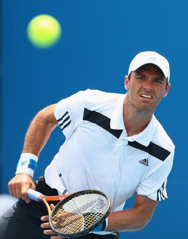 MELBOURNE, AUSTRALIA - JANUARY 15: Ross Hutchins of Great Britain serves in his first round doubles match with Colin Fleming of Great Britain against Marinko Matosevic of Australia and Michal Przysiezny of Poland during day three of the 2014 Australian Open at Melbourne Park on January 15, 2014 in Melbourne, Australia. Cameron Spencer/Getty Images