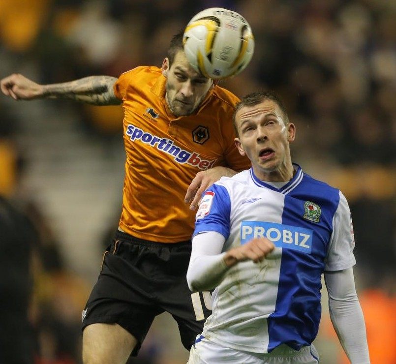 Roger Johnson, left, in action for parent club Wolves (Picture: PA)