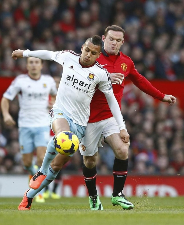 """Manchester United's Wayne Rooney (R) challenges West Ham's Ravel Morrison during their English Premier League soccer match at Old Trafford in Manchester, northern England, December 21, 2013. REUTERS/Darren Staples (BRITAIN - Tags: SPORT SOCCER) FOR EDITORIAL USE ONLY. NOT FOR SALE FOR MARKETING OR ADVERTISING CAMPAIGNS. NO USE WITH UNAUTHORIZED AUDIO, VIDEO, DATA, FIXTURE LISTS, CLUB/LEAGUE LOGOS OR """"LIVE"""" SERVICES. ONLINE IN-MATCH USE LIMITED TO 45 IMAGES, NO VIDEO EMULATION. NO USE IN BETTING, GAMES OR SINGLE CLUB/LEAGUE/PLAYER PUBLICATIONS Darren Staples/Reuters"""