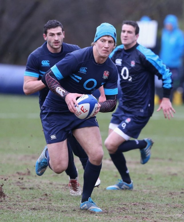 BAGSHOT, ENGLAND - JANUARY 27: Billy Twelvetrees runs with the ball during the England training session held at Pennyhill Park on January 27, 2014 in Bagshot, England. David Rogers/Getty Images