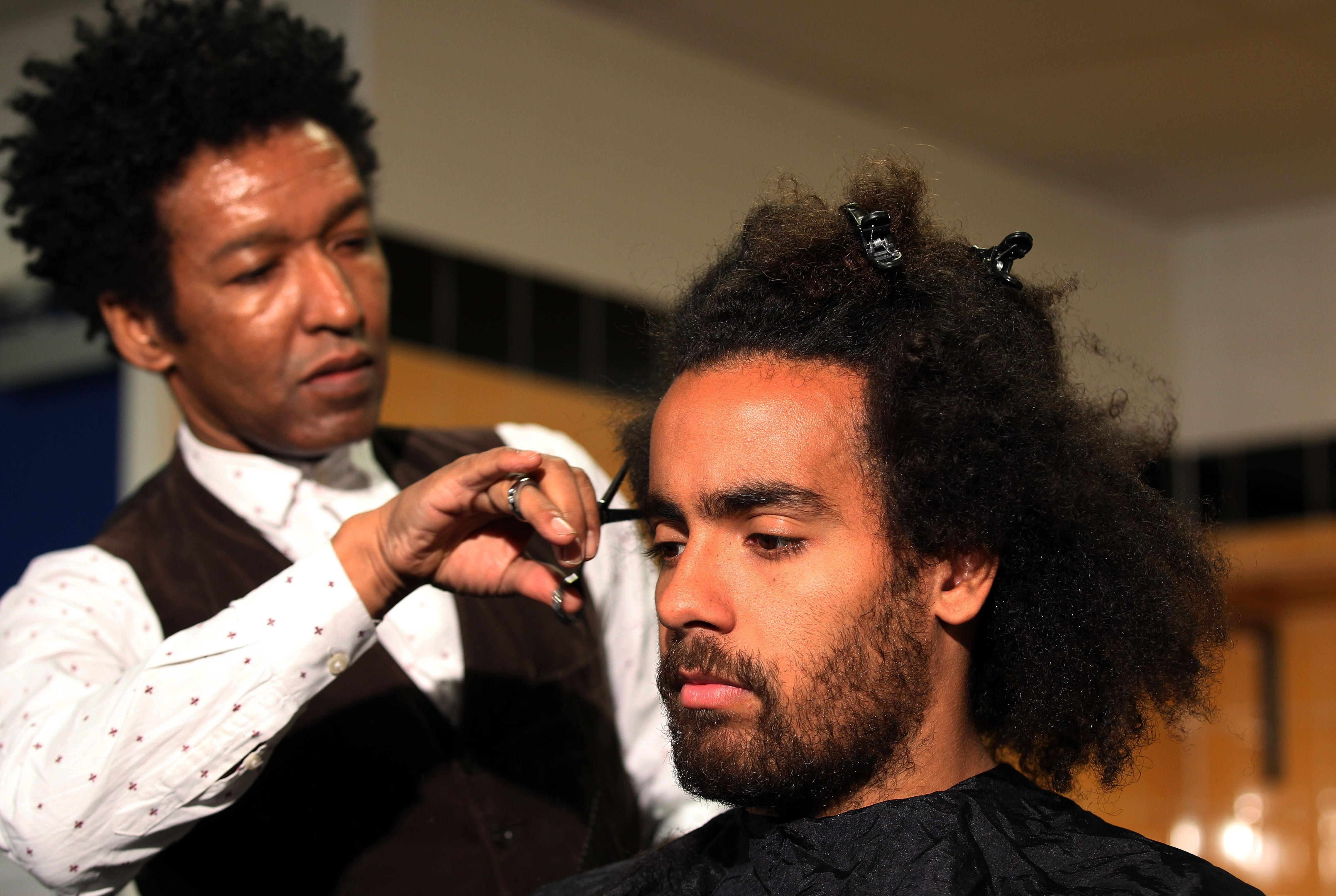 Tom Huddlestone goes with the fro for charity as Hull star has haircut to mark end of scoring drought