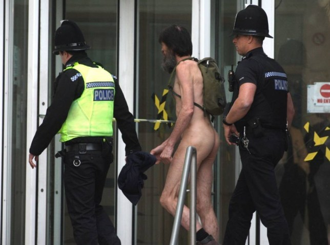 The Naked Rambler was today jailed for 16 months for breaching an ASBO banning him from exposing himself in public - after being found guilty in a record two minutes. Former Royal Marine Stephen Gough, 54, had walked out of jail naked just two days after magistrates handed him the order in court.  SEE OUR COPY FOR DETAILS. Pictured:  The Naked Rambler Steve Gough arrested for breaching his ASBO at Southampton mags court.  This is taken at the time of the original ASBO. © Daily Echo/Solent News & Photo Agency UK +44 (0) 2380 458800