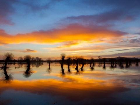 Floods still a big risk across Britain – but storms finally relent